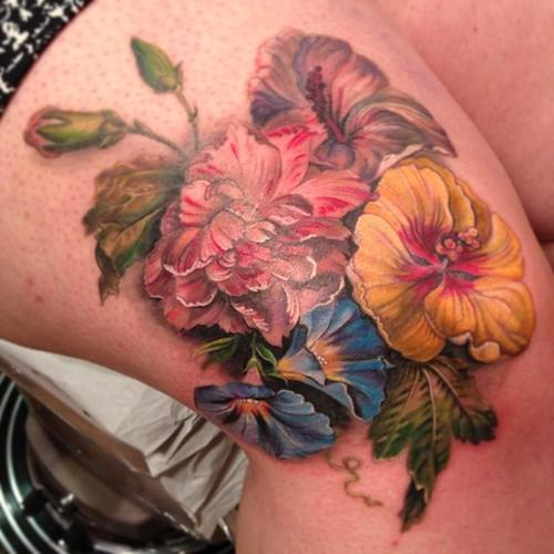 This posy of flowers was taken from a 17th century painting for this lovely, feminine tattoo by BUtterfat studios