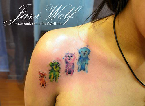 A dog lover celebrates her pets with this artistic watercolor tattoo by Javi Wolf