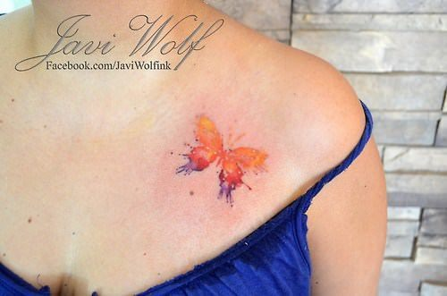 753fe2e8b A simple butterfly becomes a beautiful art work in this colorful watercolor  tattoo by Javi Wolf
