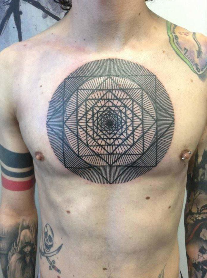 Repetitive lines and geometric shapes become a trippy mandala tattoo by Pierluigi Deliperi