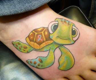 The adorable baby turtle, Squirt, from Finding Nemo becomes a forever friend in this cute and colorful foot tattoo