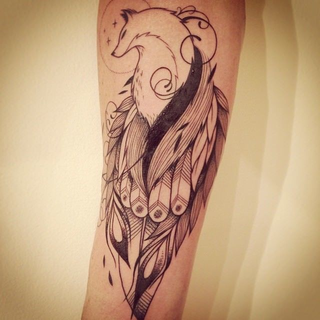 A fantasy fox wears beautiful feathers in this meditative and peaceful tattoo by Supakitch