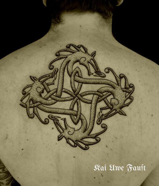 Four dragons make an orborous celtic knot in this hand poked viking tattoo by Art on the Body tattoo studio