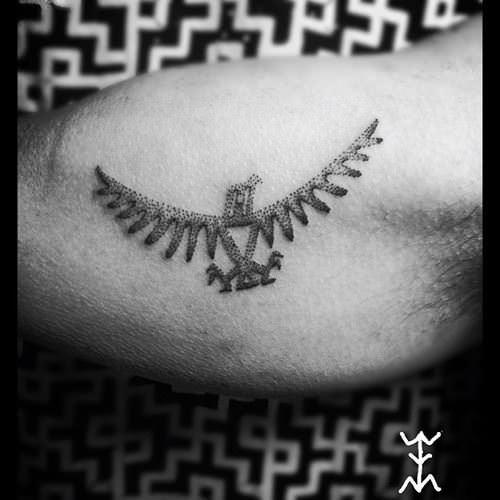 The dotwork texture of hand poked tattoos is apparent in this eagle tattoo on the bicep by Art on the Body tattoo studio in Copenhagen