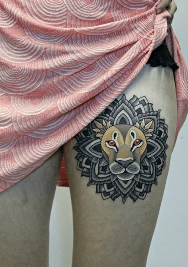 The lion totem in this meaningful tattoo design has a mandala for a mane