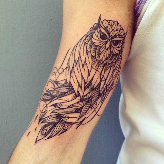 This owl tattoo by Supakitch shows off the artist's stunning linework