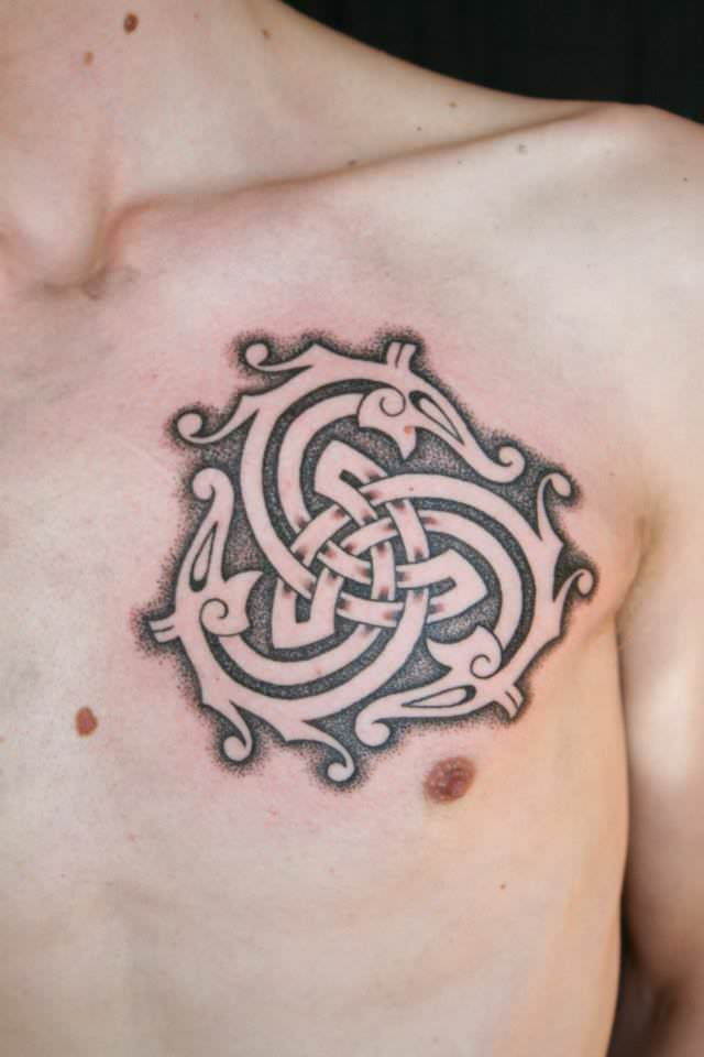 Three serpents chase one another in an eternal cycle in this celtic tattoo by Art on the Body tattoo studio