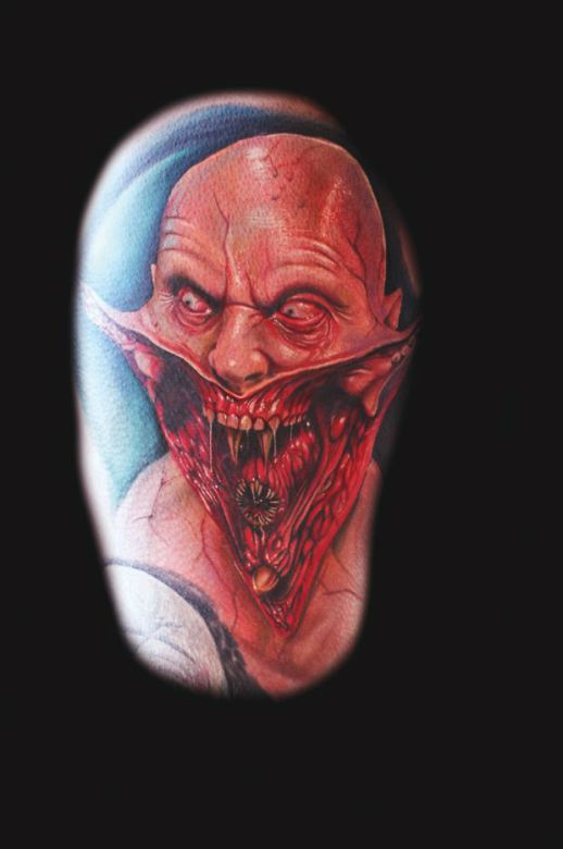 An alien humanoid reveals its freaky nature in this horror tattoo by Mario Hartmann