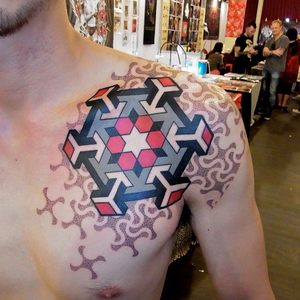 Marco Galdo's exceptional linework and dotwork skills are apparent in this geometric tattoo design