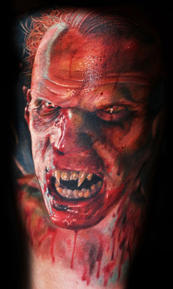 Mario Hartmann inks a horrifyingly realistic tattoo of a vampire dripping with blood