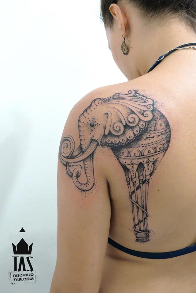 Tattoo artist Rodrigo Tas turns an elephant into a hot air balloon in this creative dotwork tattoo