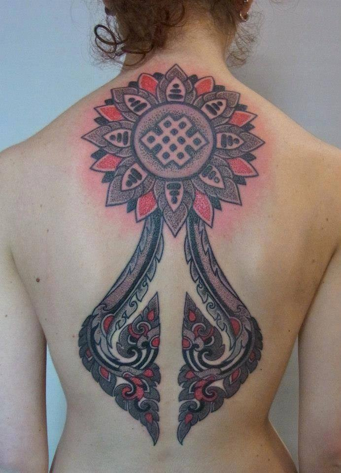 This large back tattoo by Marco Galdo is a fusion of paisley patterns and geometric mandalas