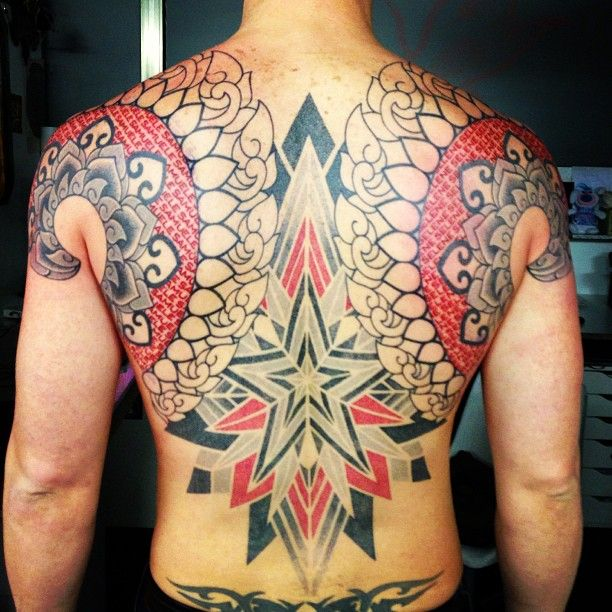 Using only black and red ink, tattoo artist Marco Galdo inks a back tattoo that is both and optical illusion and a fusion between spiritual art and graphic design
