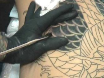 The Painful Hand-poked Method of Traditional Japanese Tattoos