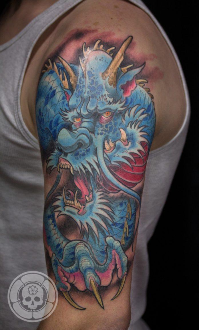 A blue Japanese dragon stalks the viewer in this tattoo by Ben Shaw