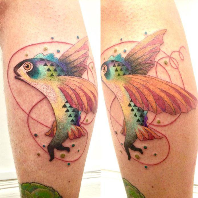 A colorful flying fish is totally confused about whether it should swim, walk or fly. Tattoo by Amanda Chamfreau