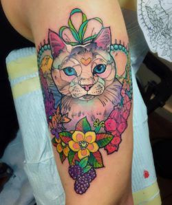 A pet lover asked tattoo artist Katie Shocrylas to turn a photo of her beloved cat into a beloved tattoo