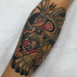 An extinct triceratops comes back to life in this exquisite neo-traditional tattoo by Rodrigo Kalaka