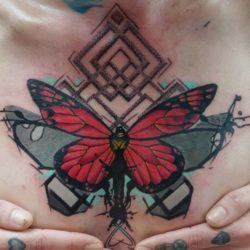 Dynos combines a variety of art styles in this butterfly chest tattoo