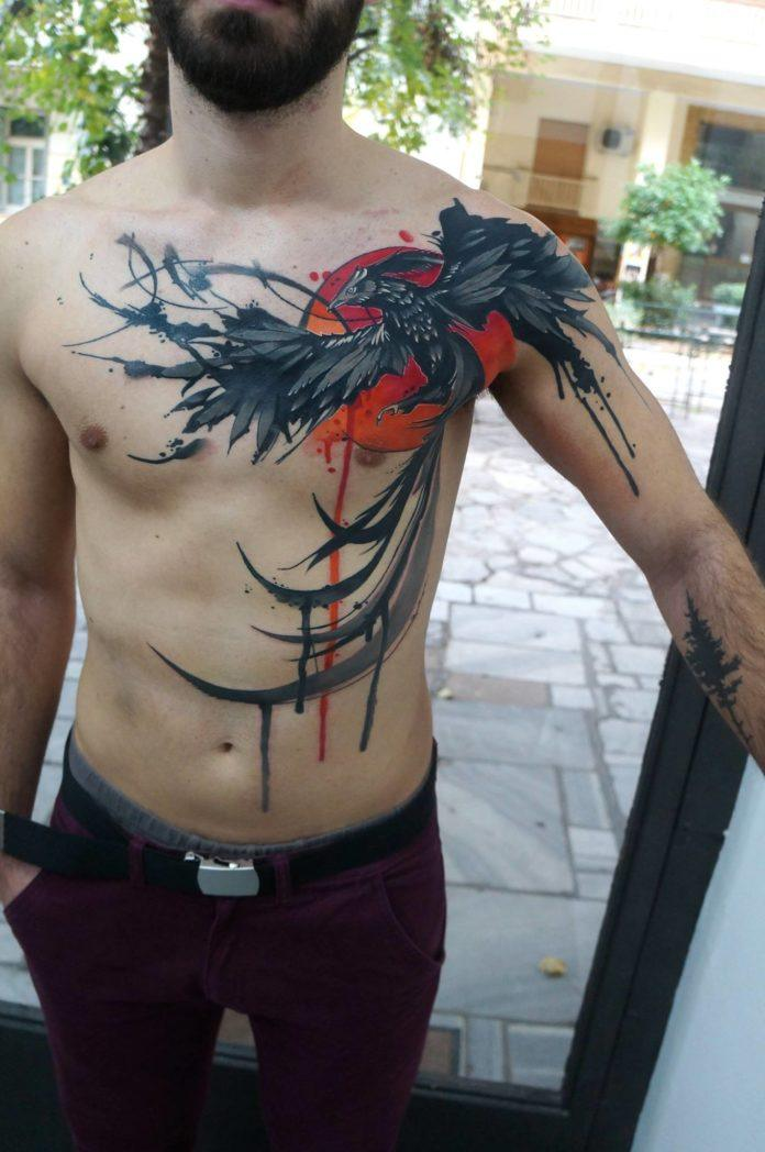 Greek tattoo artist Dynoz inked this incredible watercolor tattoo of a phoenix rising from the ashes in front of a blazing hot sun