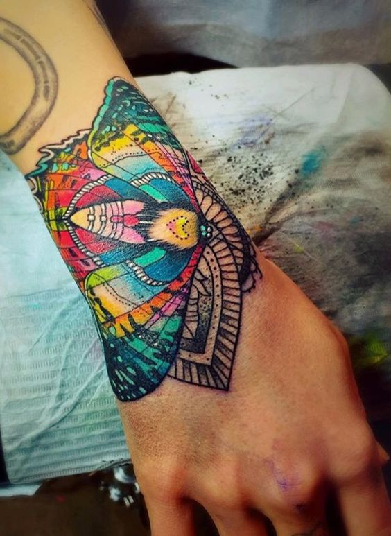 Katie Shocrylas shows off her talents with a tattoo machine in this intricate and colorful moth tattoo
