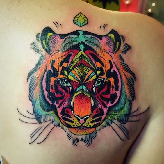 Katie Shocrylas uses UV tattoo inks to make this tiger tattoo stand proud