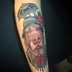 Rodrigo Kalaka combines semi-realism and traditional tattoo styles in this tattoo of a dog dressed as an old lady