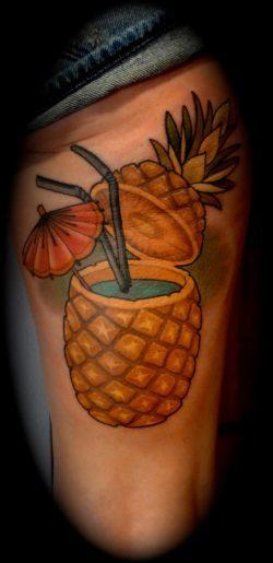 Rodrigo Kalaka gives his client a splash of color with this fruity pina colada tattoo