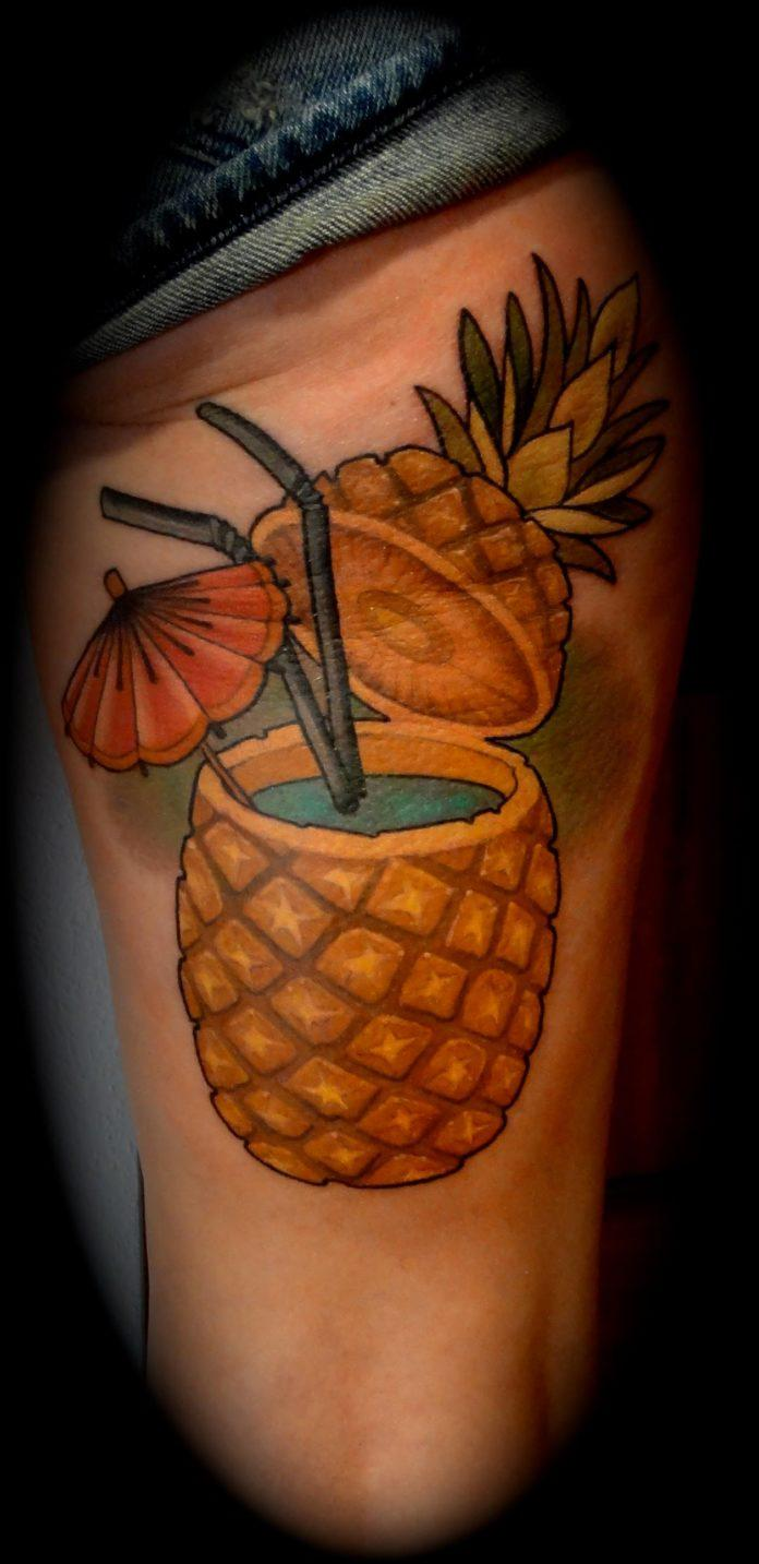 Rodrigo Kalaka gives his client a splash of color with this fruity pina colada tattoo