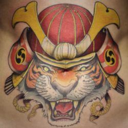 Tattoo artist Ben Shaw makes this snarling tiger a samurai warrior by giving it the traditional helmet of Japanese warriors.