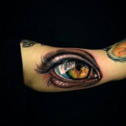 This stunning photo realistic eye tattoo is by the Turkish tattoo artist Jefree Naderali