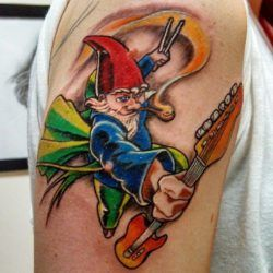 A gnome musician charges with his guitar in this musical tattoo