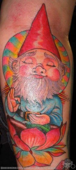 A very zen gnome meditates while sitting in a lotus flower in this colorful tattoo