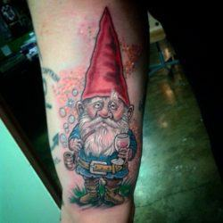 An intoxicated gnome is featured in this funny tattoo