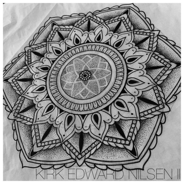 Before tattooing a design, Kirk Nilsen carefully draws the exact size and proportions to make sure that his sacred geometry tattoos are perfect