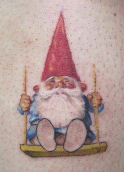 This adorable tattoo shows a rosy cheeked gnome on a swing