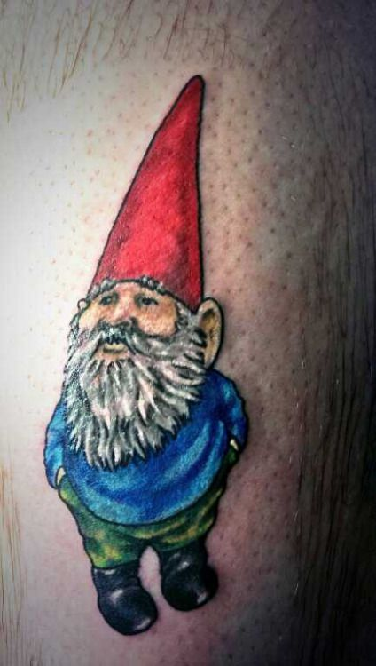 This colorful tattoo shows David the Gnome in his red hat and blue jacket
