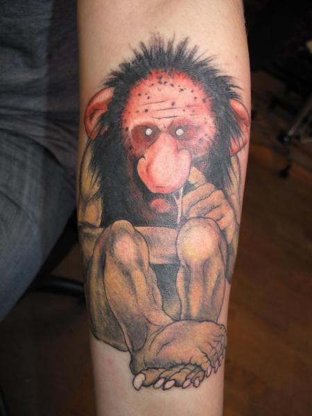 This tattoo shows one of the ugly, nasty trolls from the gnomes books picking his nose