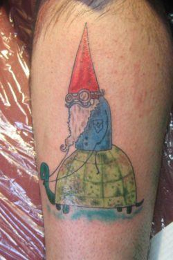 While this gnome tattoo shows a gnome with a pointy red hat and a blue jacket, just like in the TV series, the style of the illustration is unique