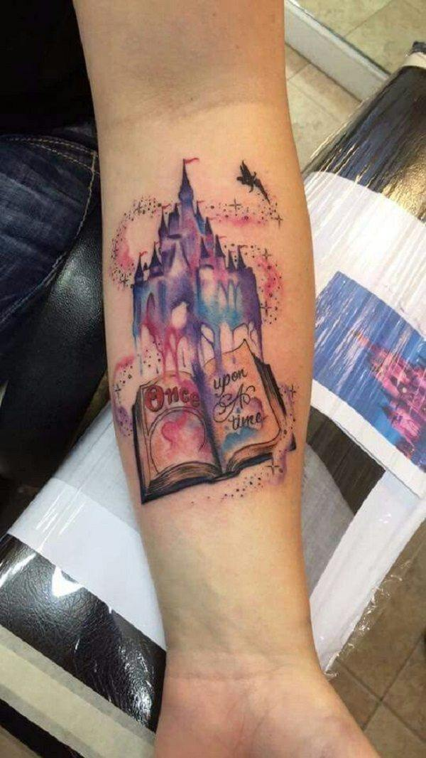 A fairy tale castle rises up out of this book tattoo, a symbol of the magic that books contain for the tattoo lover