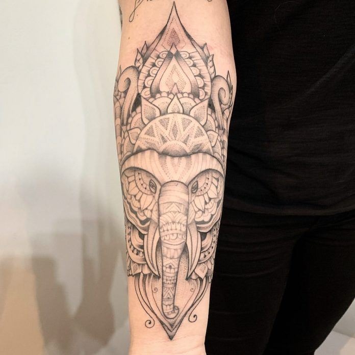 This dot work tattoo by José Flávio Audi combines the wisdom of the elephant with the spiritual symbolism of mandala and lotus flowers.