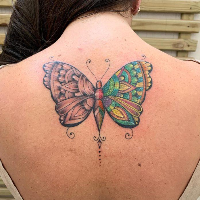 This half color ink and half black ink butterfly tattoo by José Flávio Audi shows off the tattoo artist's skills with both design and tattooing.