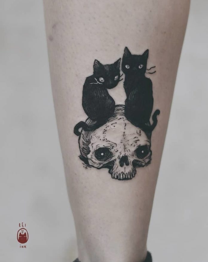 Only tattooer Daria Rei could design a tattoo of two evil kittens this cute