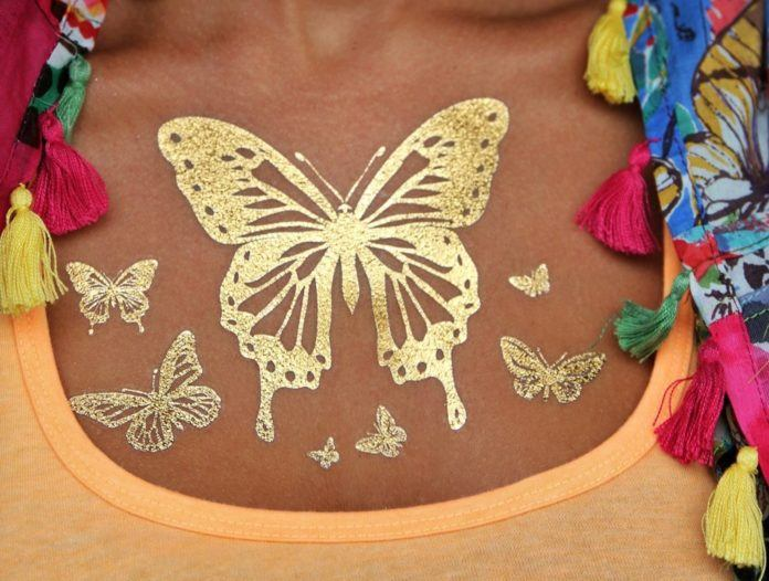 Shimmery metallic transfer tattoos like these golden butterflies look absolutely fabulous on darker skin tones