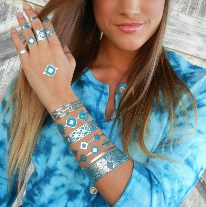 These temporary tattoo of rings and bracelets use turquoise and silver metallic inks