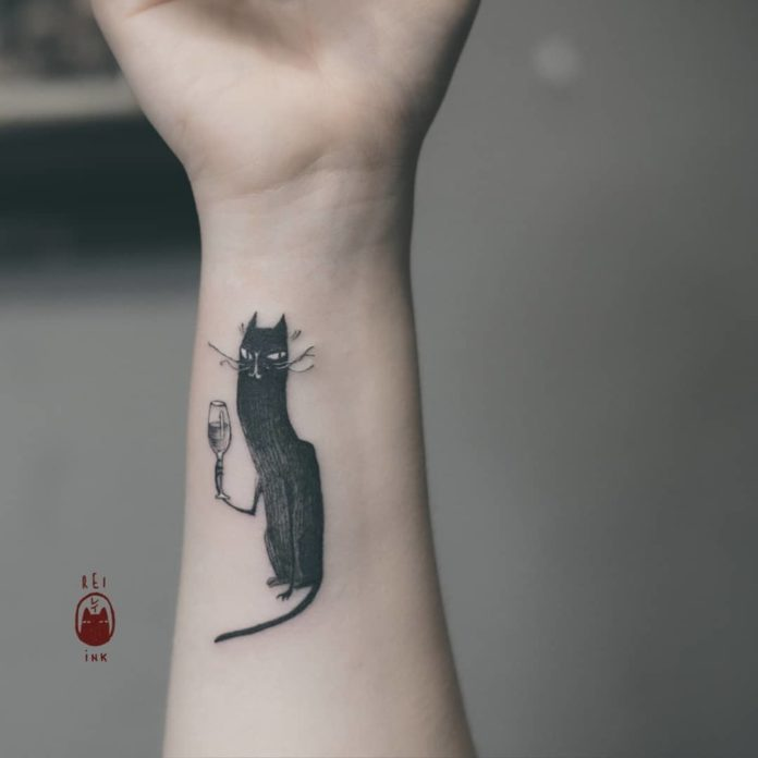 This posh cat holds a glass of wine while plotting the demise of its enemies in this cat tattoo by Berlin-based tattoo artist Daria Rei