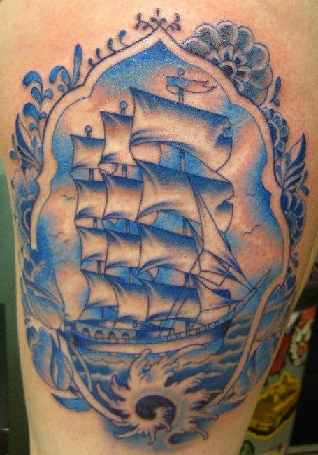 Tattoo artist Guen Douglas has used different colors of blue ink to create this Delft Blue tattoo of a Dutch sailing ship from the 17th century