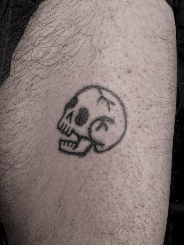This small skull hand poke tattoo took the artist around two hours of careful inking to make